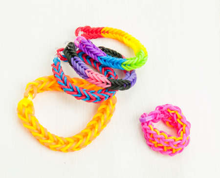 banding: colourful elastic loom band bracelets against a white table top Stock Photo