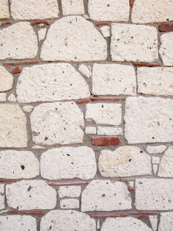 deatil: deatil of reproduction aged stone wall with grey stonework red tiles and dark grey mortar Stock Photo