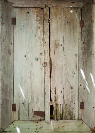 knotty: closeup of  of a rotten old wooden doorway