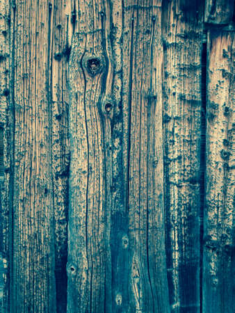 cross processed: background of knotted aged heavily grained pine shutter boards. cross processed. Stock Photo