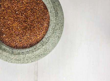 red quinoa: overhead detail of red quinoa in a rustic stoneware bowl