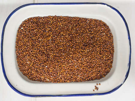 red quinoa: close up overhead view of red quinoa in an old fashioned enamel dish Stock Photo