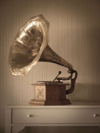 phonograph: antique phonograph in classical interior with vegnetting and aged filter applied Stock Photo