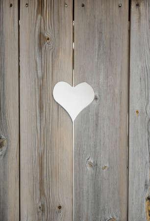 heart motif in grey aged wooden shutterboard fence