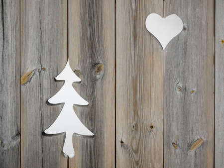 christmas tree and heart motifs in grey aged wooden shutterboard fence