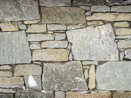 detail of grey stone wall for background