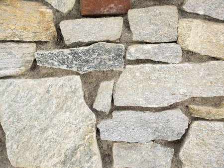 closeup detail of grey stone wall for background Stock Photo