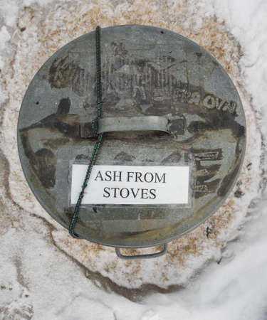 stoves: overhead view of metal bin with tect ash from stoves