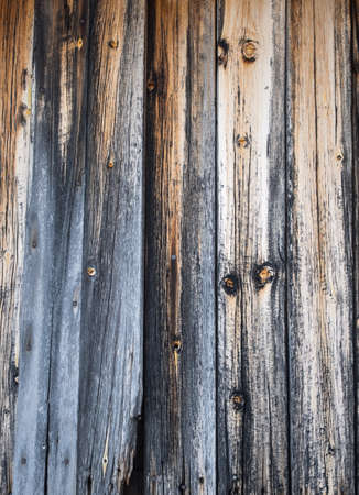 weathered greyed logs of cabin wall for background Stock Photo