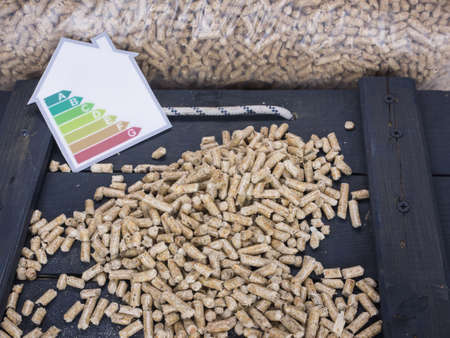wood pellet: wood pellets on a trap door with wood pellet  store and energy lable behind