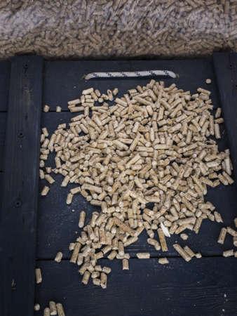 wood  pellets in a wood store with sacks of wood pellets behind