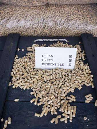 wood pellet: wood pellets in a wood pellet store with a check list carrying the words clean, green, responsible, with ticks against each