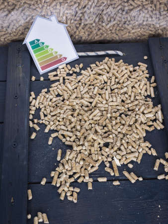 wood pellets: wood pellets on a trap door with wood pellet  store and energy lable behind