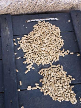 wood pellets: wood  pellets in a wood store with sacks of wood pellets behind