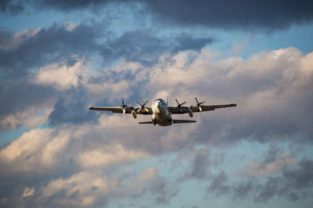 A Japanese Self Defense Force C-130 Transport takes off from Naval Air Station Atsugi, an air base shared by the JSDF and the US Navy located in Kanagawa Prefecture, Japan.  This aircraft was practicing take-offs and landings at the time of this photo.