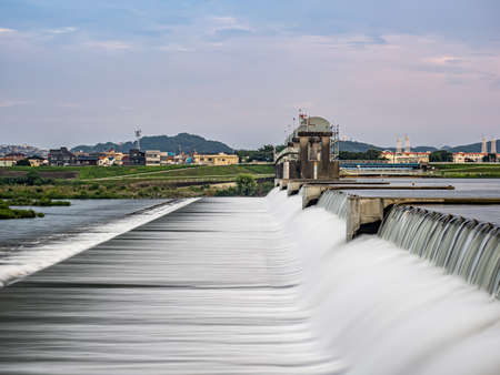 A long exposure of the Nikaryo Kamigawara seki, a weir on the Tama River near Kawasaki, Japan