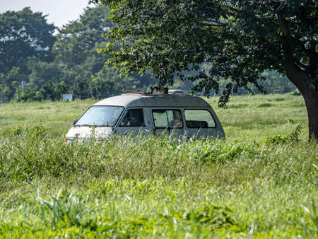 An abandoned old van rusts in a field in the former U.S. Navy Kamiseya housing area. Recently returned to the city of Yokohama, this land is now commonly used by local farmers.