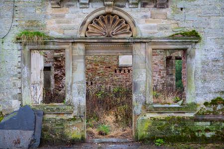 doorway: Doorway to a derelict stone mansion.