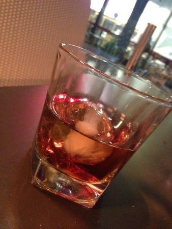 Glass of whiskey in a bar smokey old fashioned