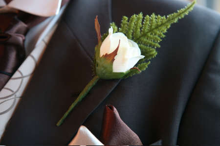 buttonhole: A grooms buttonhole in his lapel Stock Photo