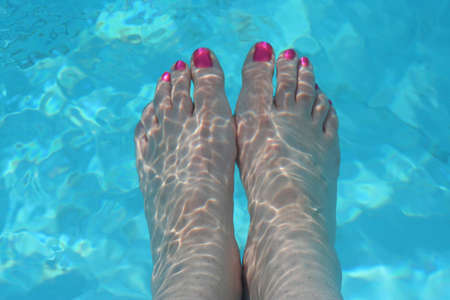 soaking: Feet soaking in the pool
