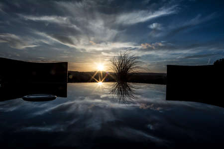 porches: Sunset with clouds with reflection from a terrace Stock Photo