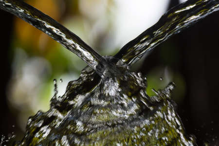 Two streams of water colliding Stock Photo