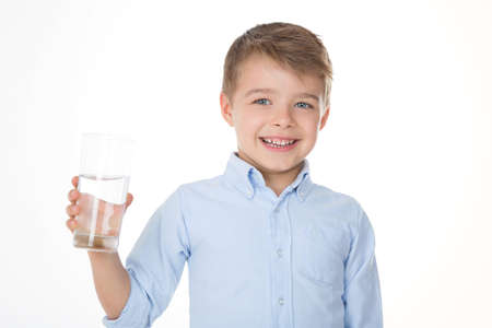 kid holding a glass in his hand Stock Photo