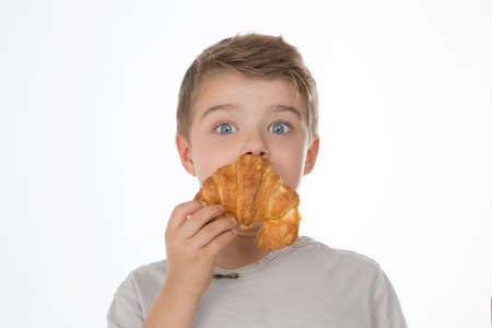 amazed child with croissant