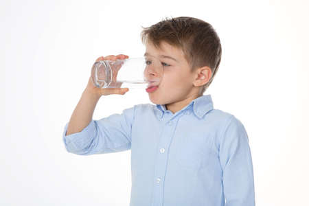people drinking water: little boy with glass of water Stock Photo