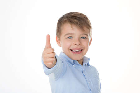 boy laughing with his thumb up photo