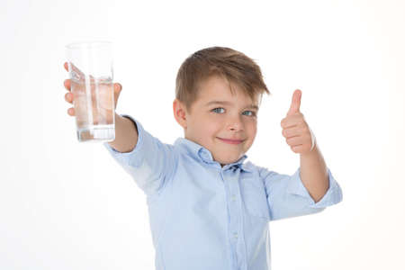 drinking water sign: young boy says ok holding a glass of water