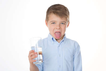 boy refusing to drink water