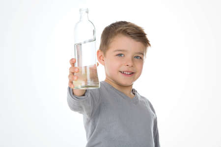 kid shows a bottle of water