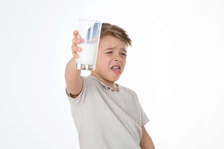 repugnant: kid refuses to drink milk Stock Photo