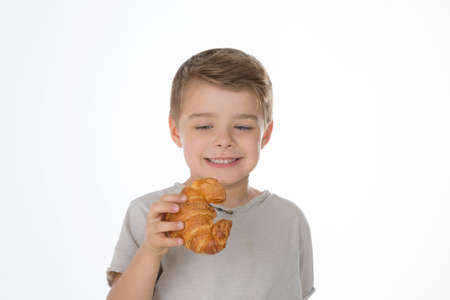 tempting: child looks at a tempting baked sweet Stock Photo