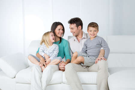 lifestyle caucasian: adorable family happily looking each other