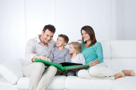 father reads a story to his children