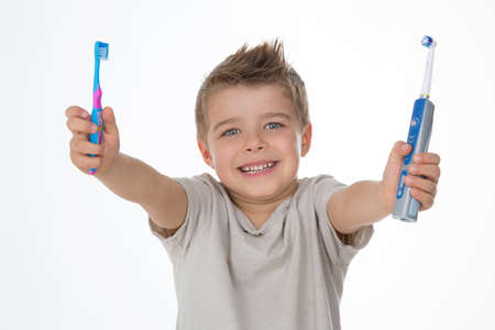 joyful kid raises his toothbrushes