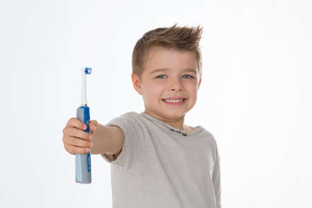 kid exhibits his brand new electric toothbrush Stock Photo