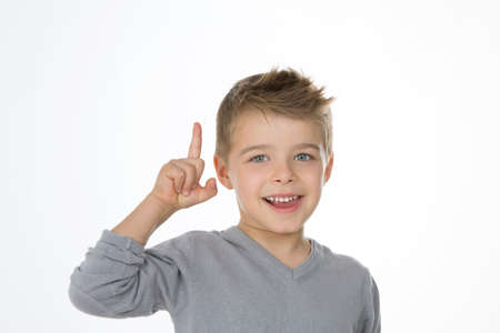 young child exults with his finger up