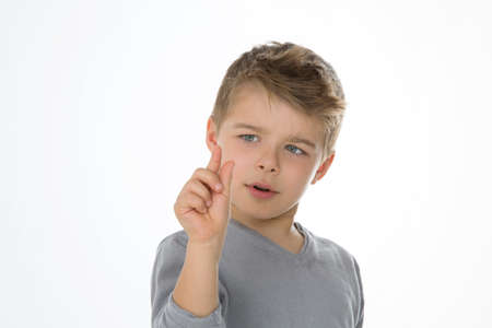 evaluated: little boy measures length with his hand