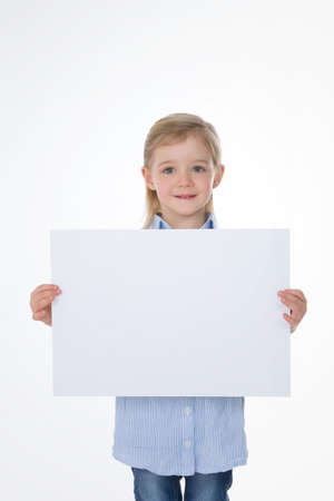 little child shows rectangular blank page photo