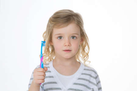 young child worried before washing her teeth photo