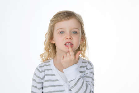 baby tooth: worried child proudly showing her baby tooth Stock Photo