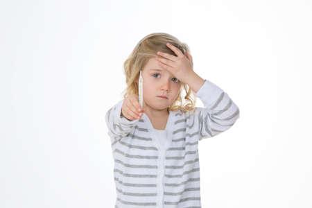 worried child shows her high body heat photo