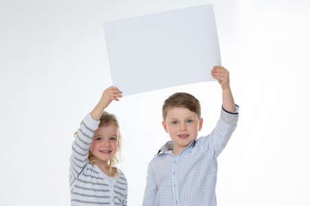 front raise: two children lifting empty and rectangular panel Stock Photo