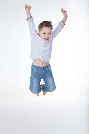 happy young boy jumping and laughing Stock Photo