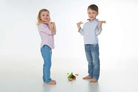 two children with a fallen vase of pottery photo