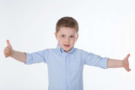 tallness: young child opens his arms widely